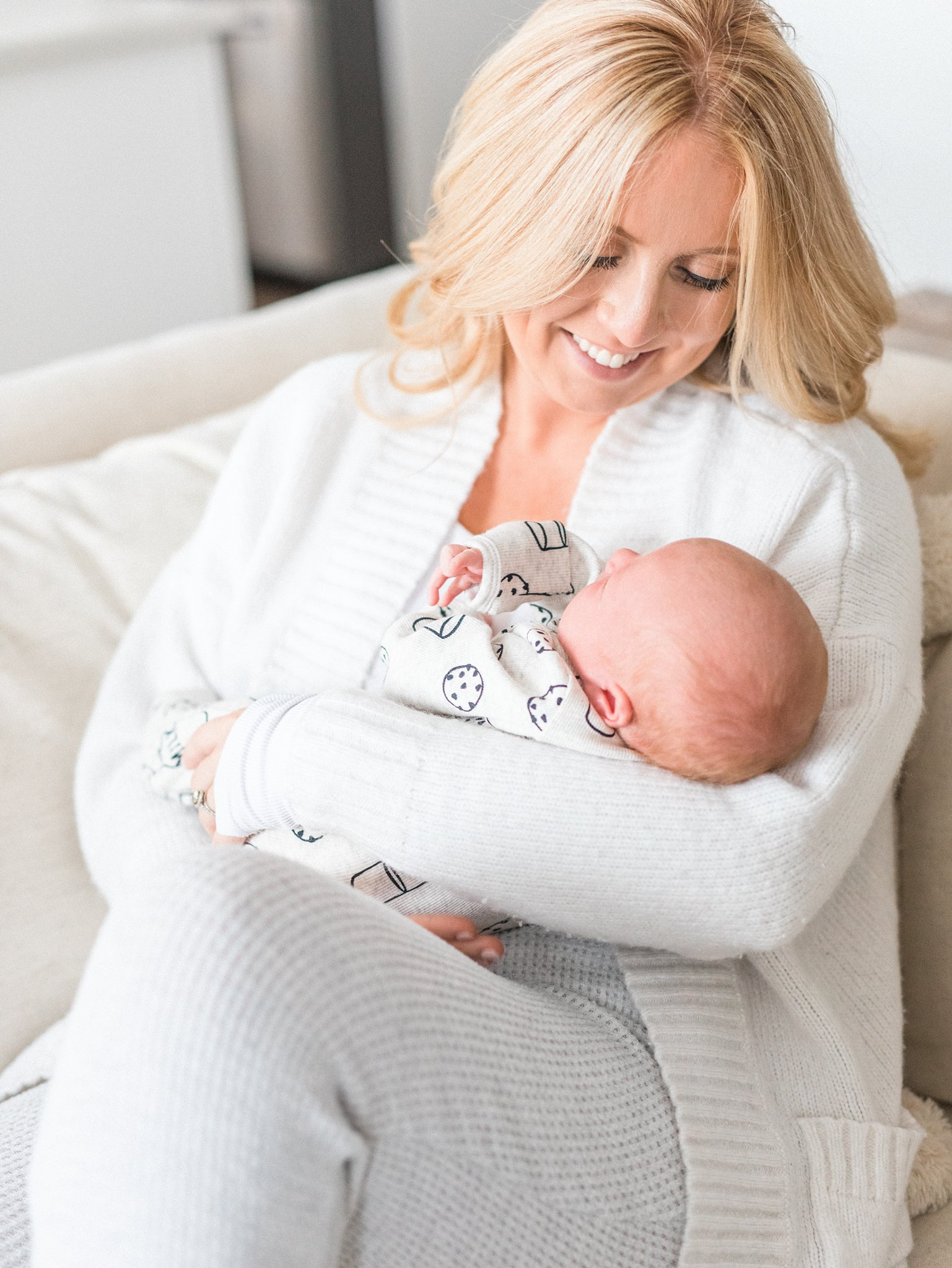 Mother cuddles baby, Festive Newborn Lifestyle Photos During the Christmas Holidays