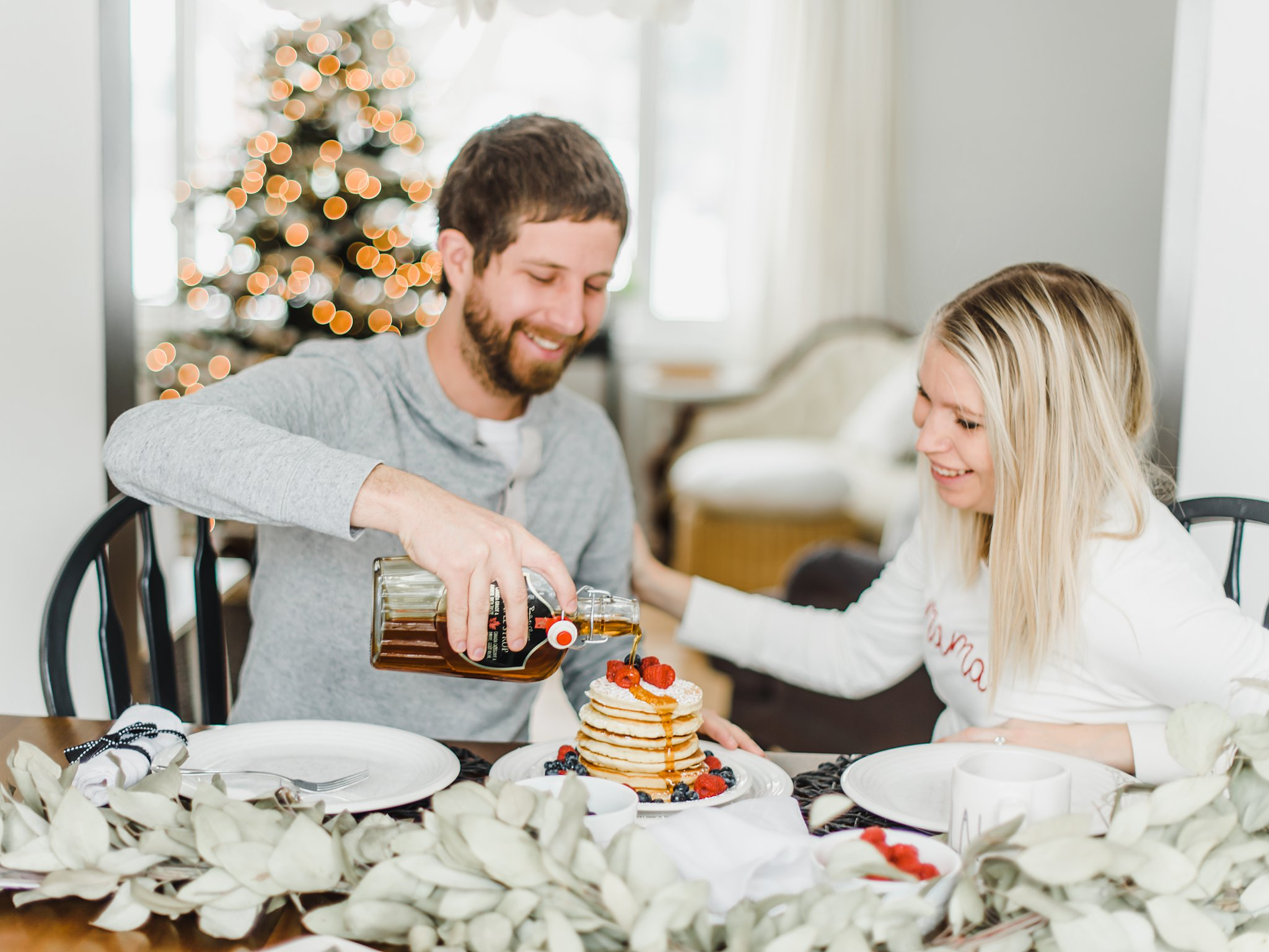 Pouring maple syrup on pancakes, Lifestyle Maternity Photos in Ottawa on 'Pancake Sunday'