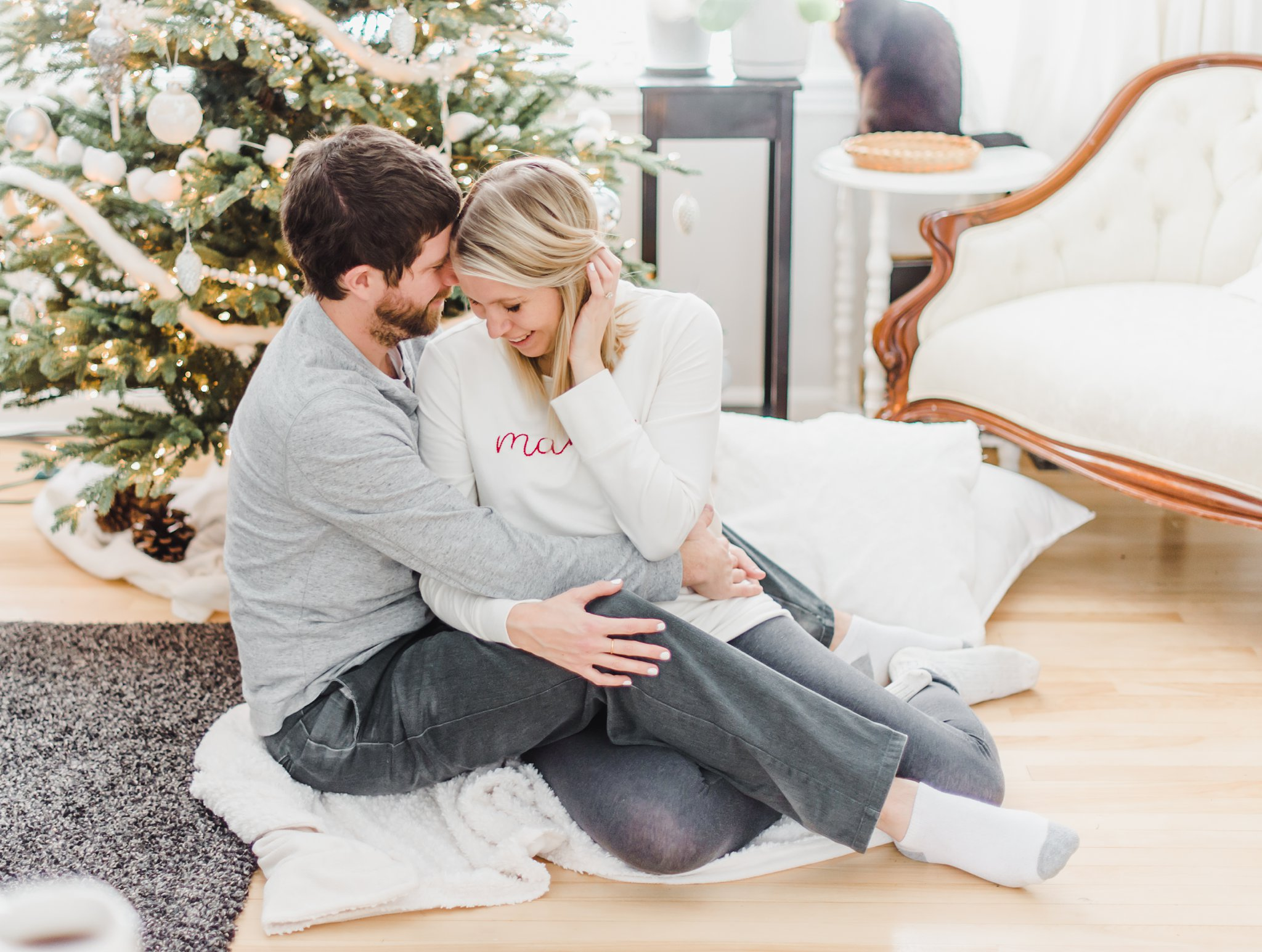 Cuddles by the christmas tree, Lifestyle Maternity Photos in Ottawa on 'Pancake Sunday'