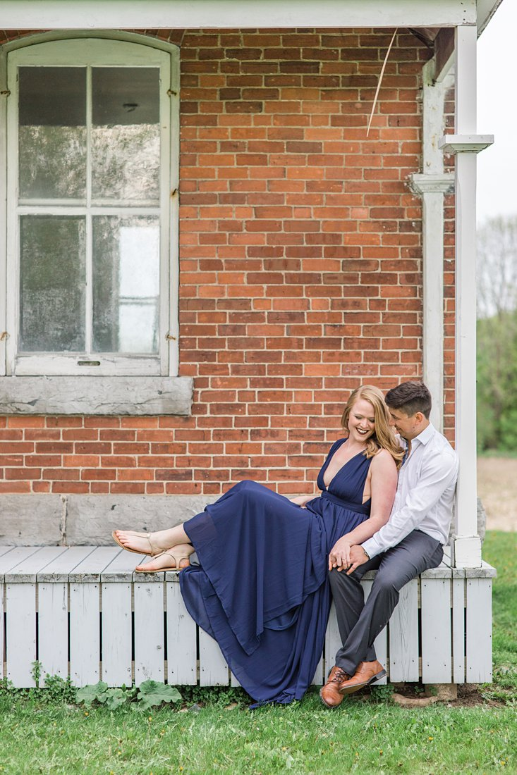 Sitting on old porch Farmhouse Engagement Photos