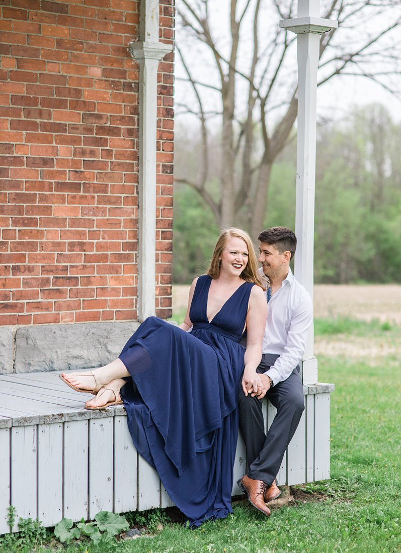Sitting on the front porch Farmhouse Engagement Photos