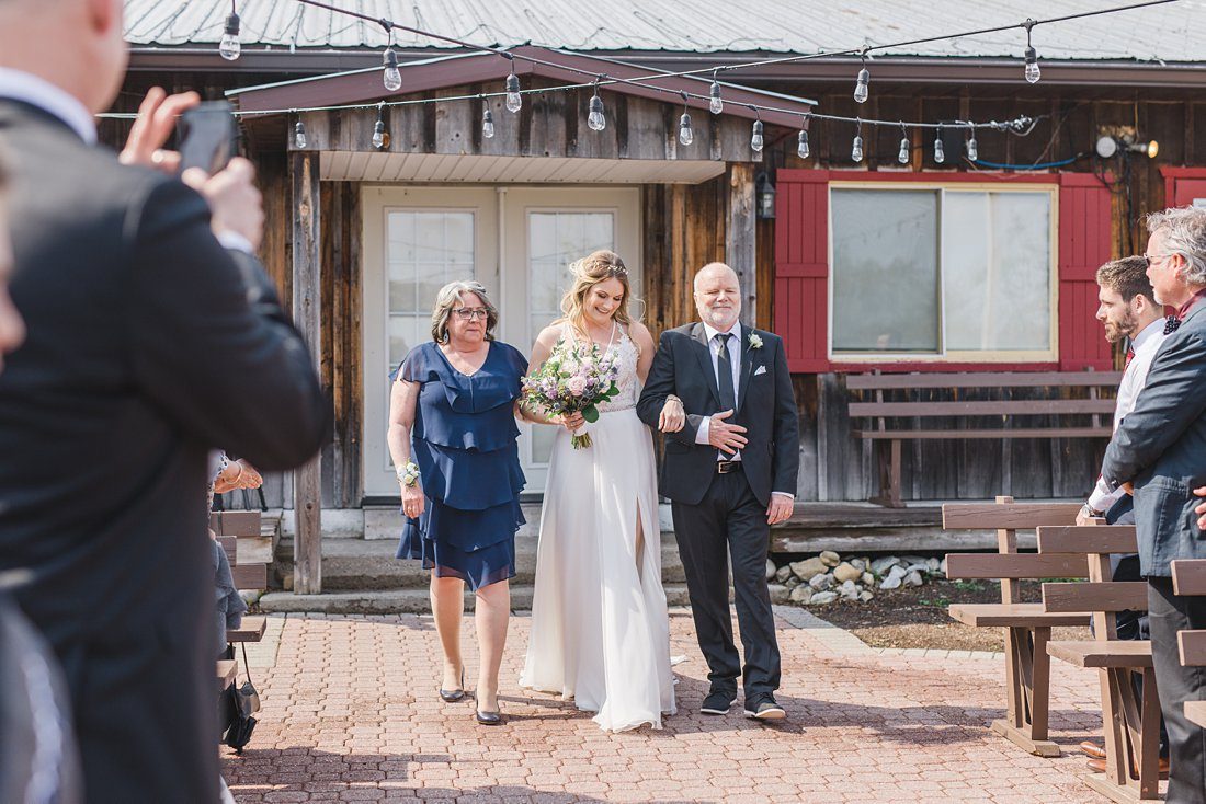 Both parents walk bride down the aisle Strathmere Lodge Wedding