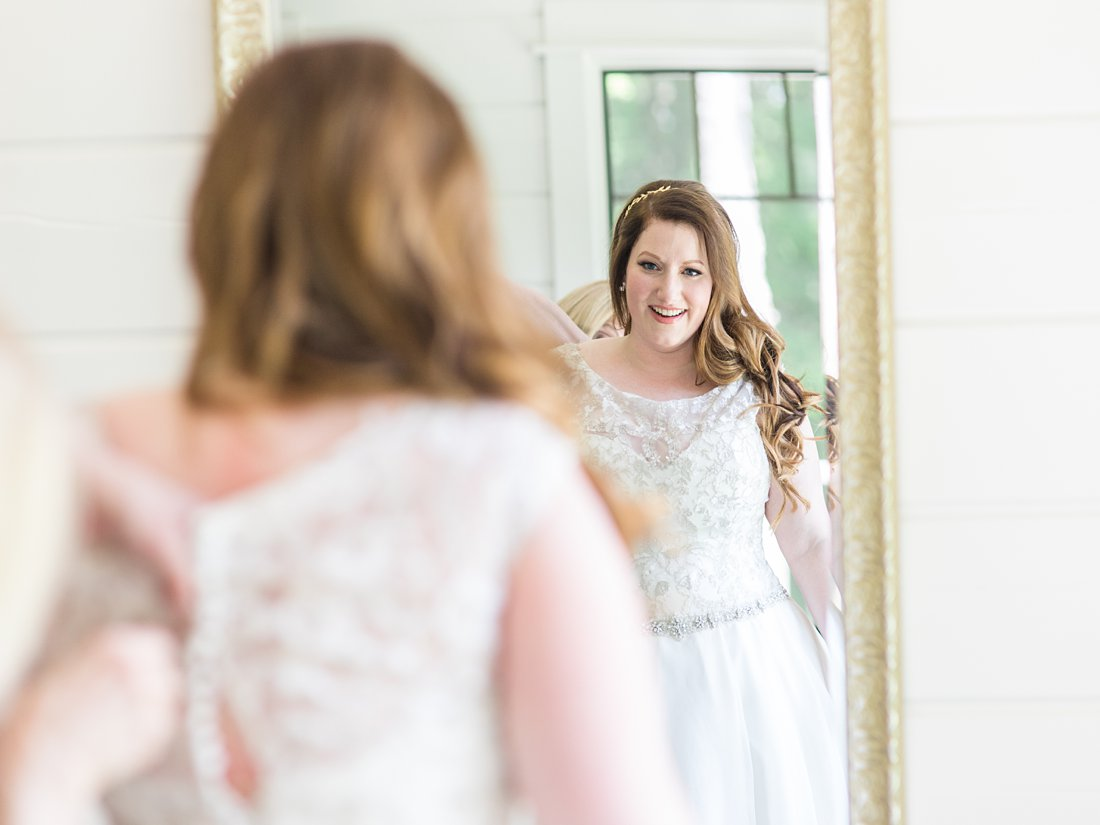 Bride gets dressed, hair extensions, mirror, reflection, A Sage Green Summer Wedding at Le Belvedere