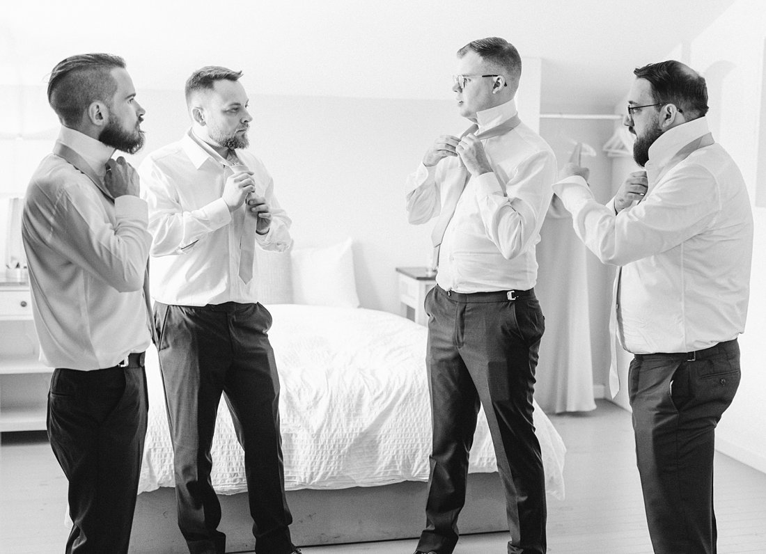 groom prep, guys get ready, black and white, A Sage Green Summer Wedding at Le Belvedere