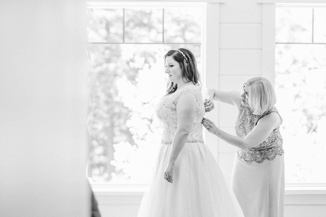 Mother helps bride get dressed, mom and bride, A Sage Green Summer Wedding at Le Belvedere