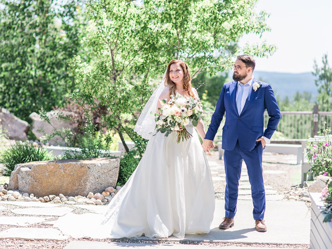 happy bride, standing, A Sage Green Summer Wedding at Le Belvedere