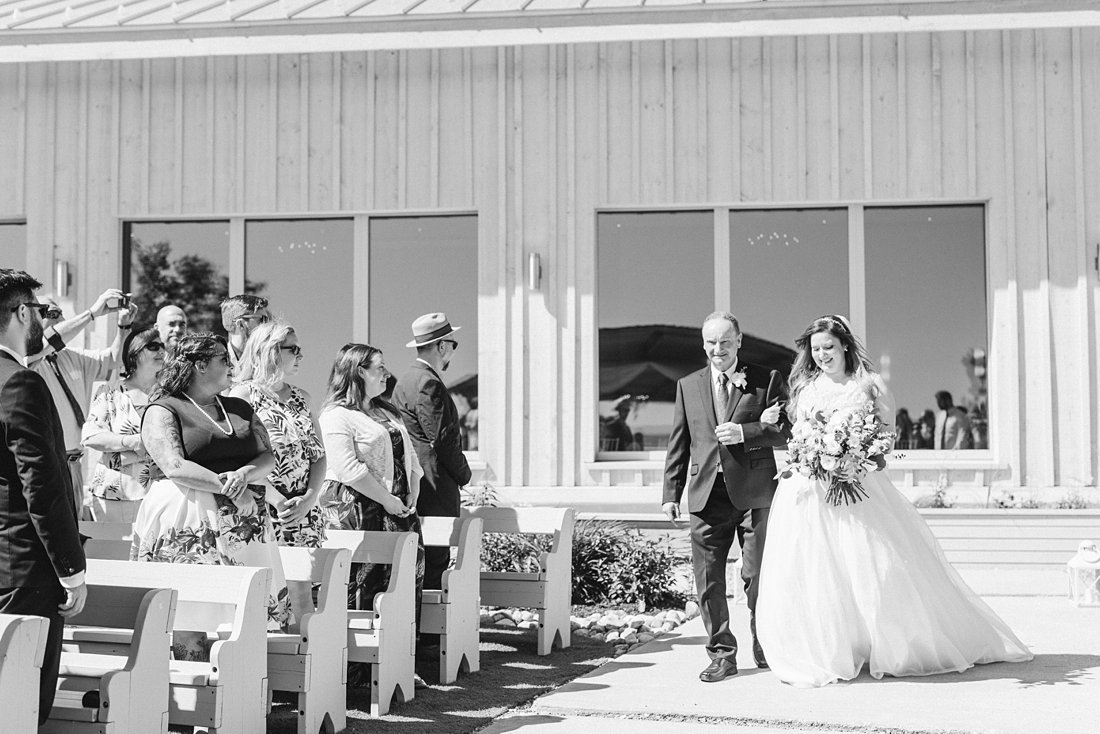 bride and father walk down aisle, A Sage Green Summer Wedding at Le Belvedere