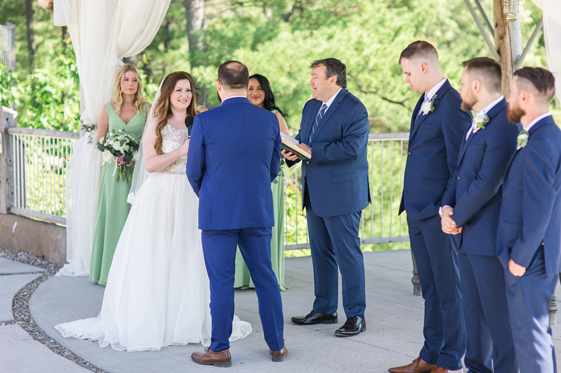 bride says vows, ceremony, A Sage Green Summer Wedding at Le Belvedere