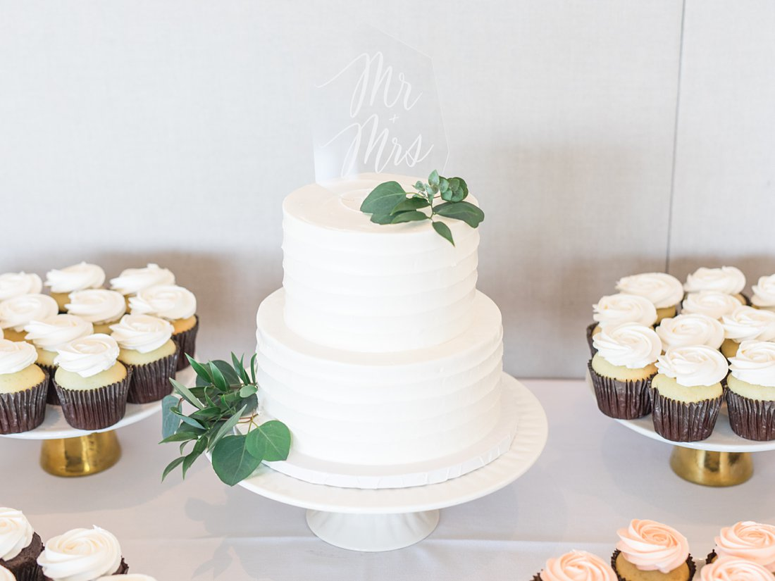 white cake, clear cake topper, calligraphy, cupcakes, A Sage Green Summer Wedding at Le Belvedere