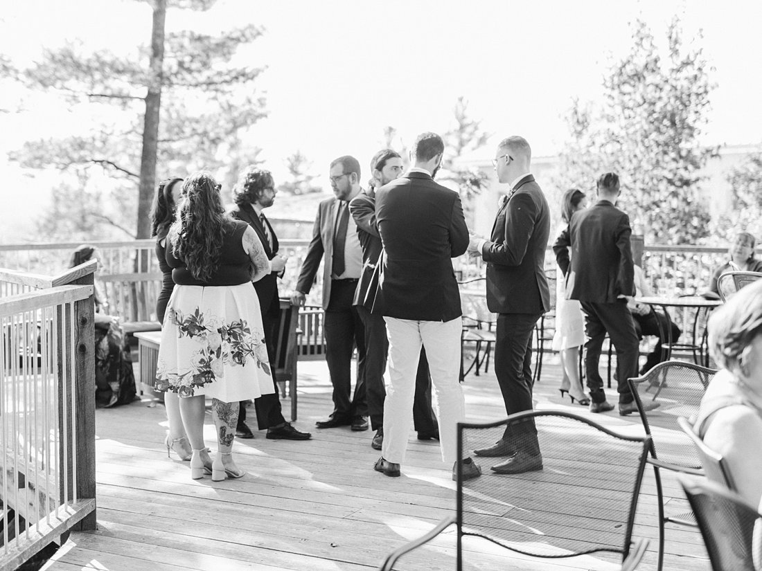 cocktail hour, candid, A Sage Green Summer Wedding at Le Belvedere