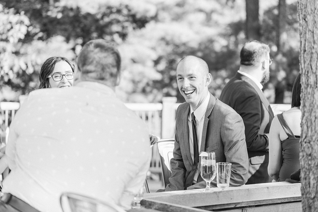 candid, cocktail hour, A Sage Green Summer Wedding at Le Belvedere