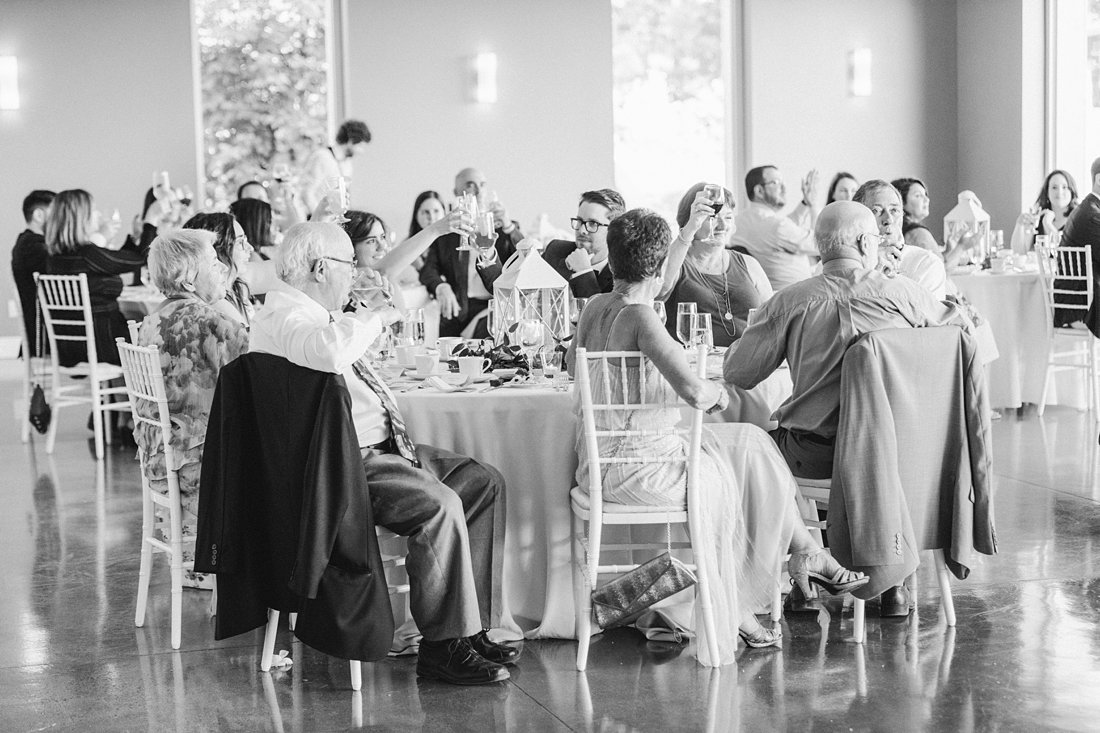 guests cheers, A Sage Green Summer Wedding at Le Belvedere