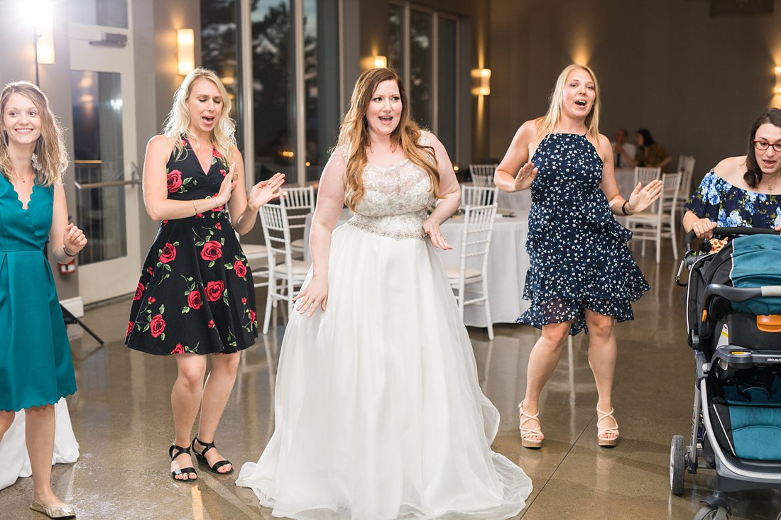 dance to spice girls, bride dancing, reception, A Sage Green Summer Wedding at Le Belvedere