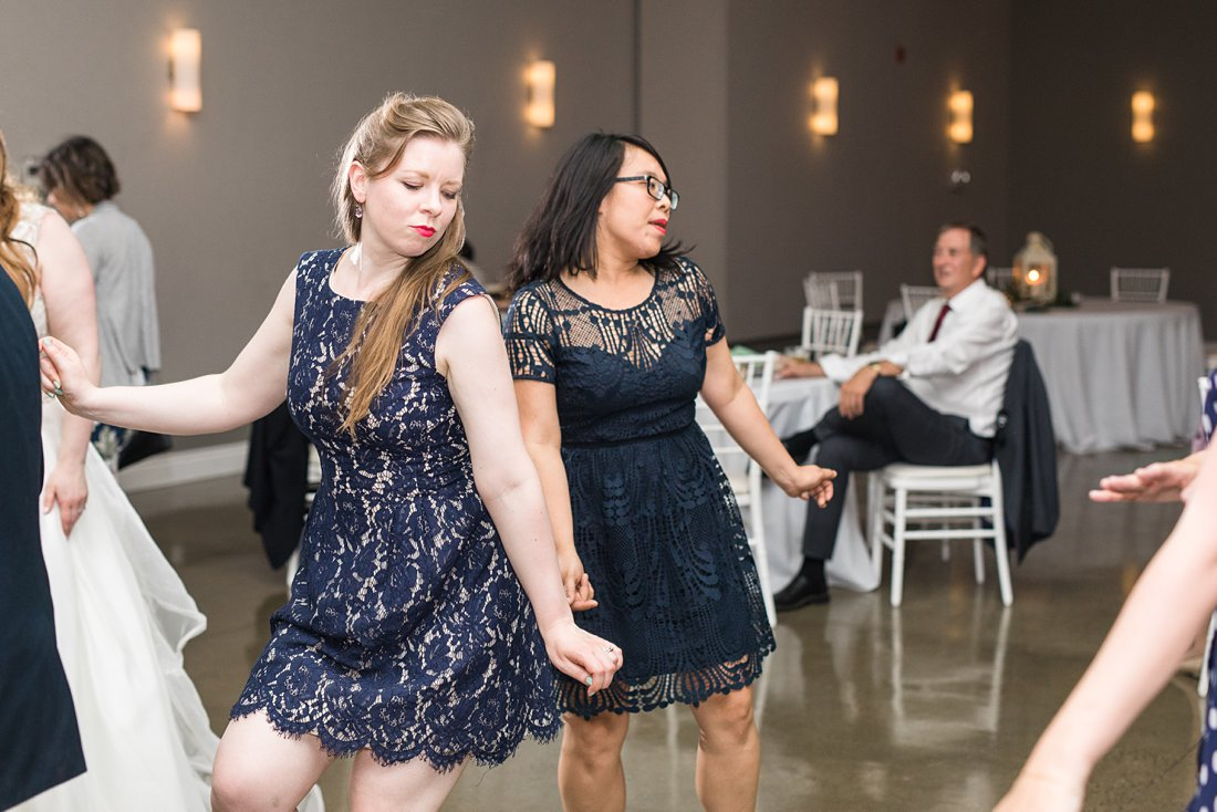 dance floor, guests, girl in blue dress, A Sage Green Summer Wedding at Le Belvedere