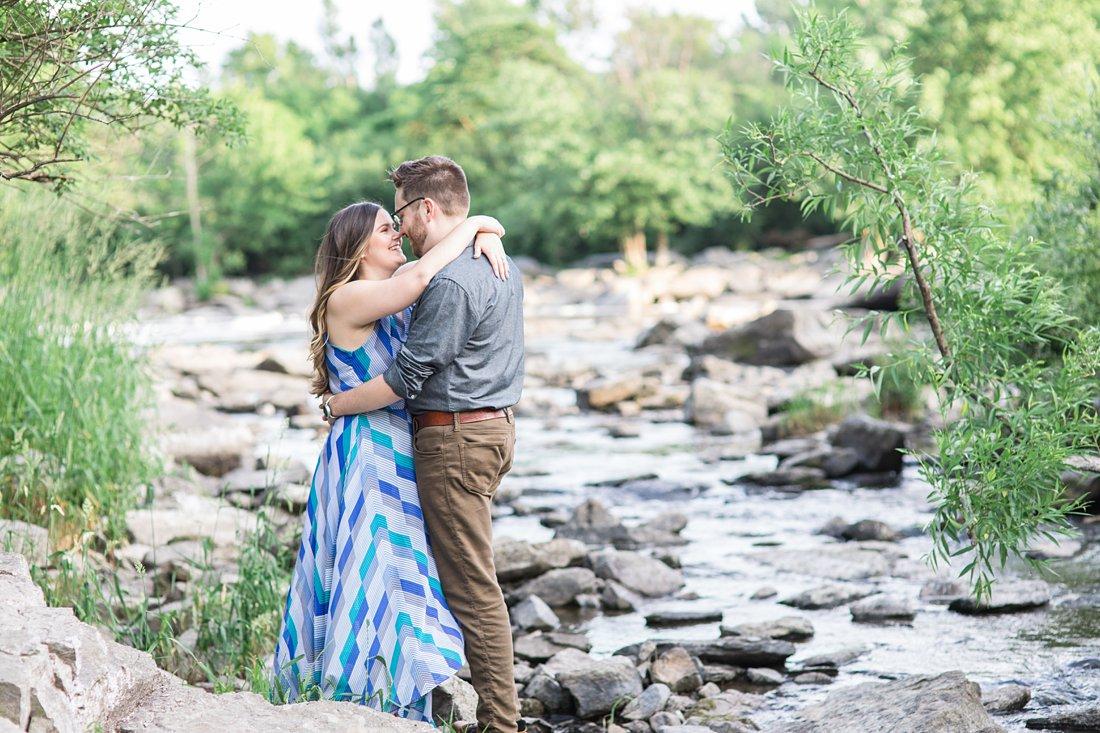 Rocky waterfront, couple posing, Hogs Back Ottawa engagement photos