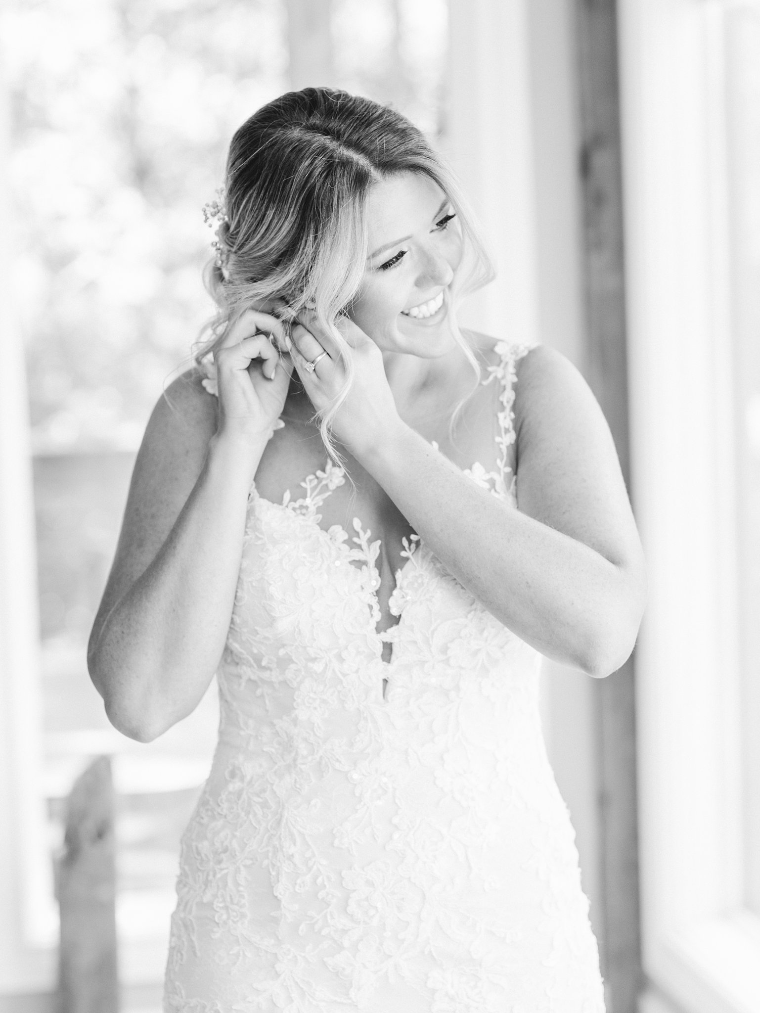 Bride putting on earrings, Howard, Private Estate Wedding Photos, Amy Pinder Photography