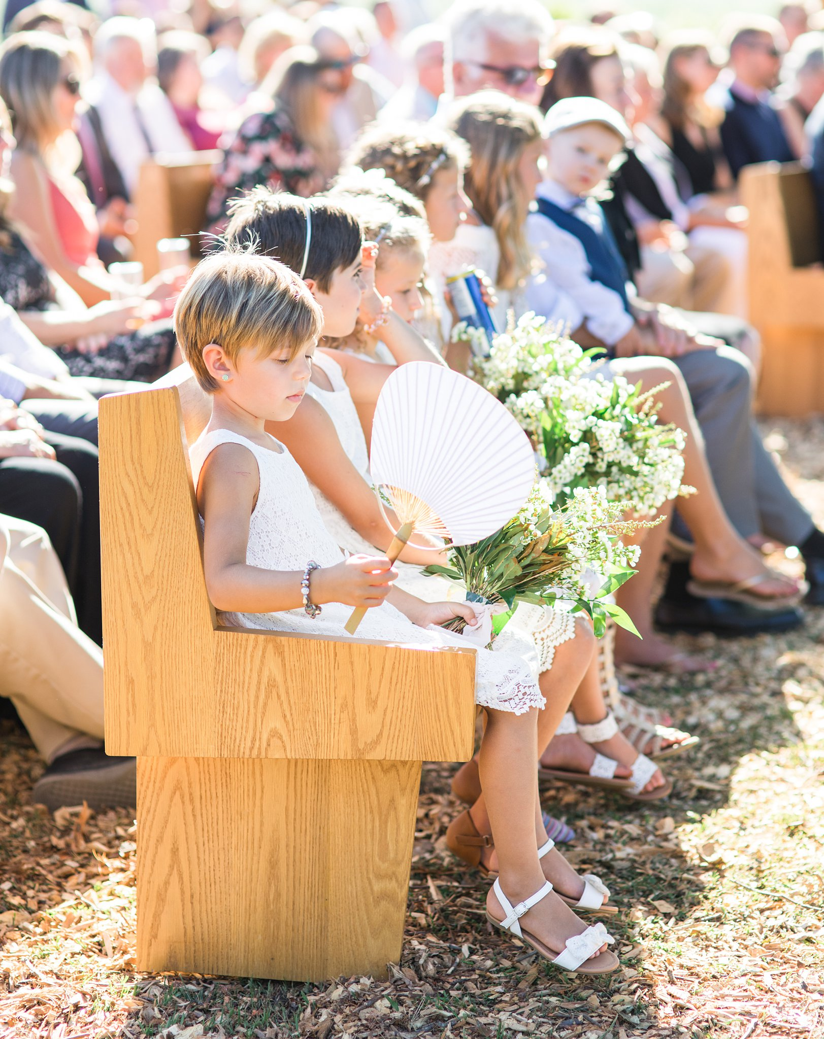 Outdoor ceremony, flower girl, paper fan, Private Estate Wedding Photos, Amy Pinder Photography