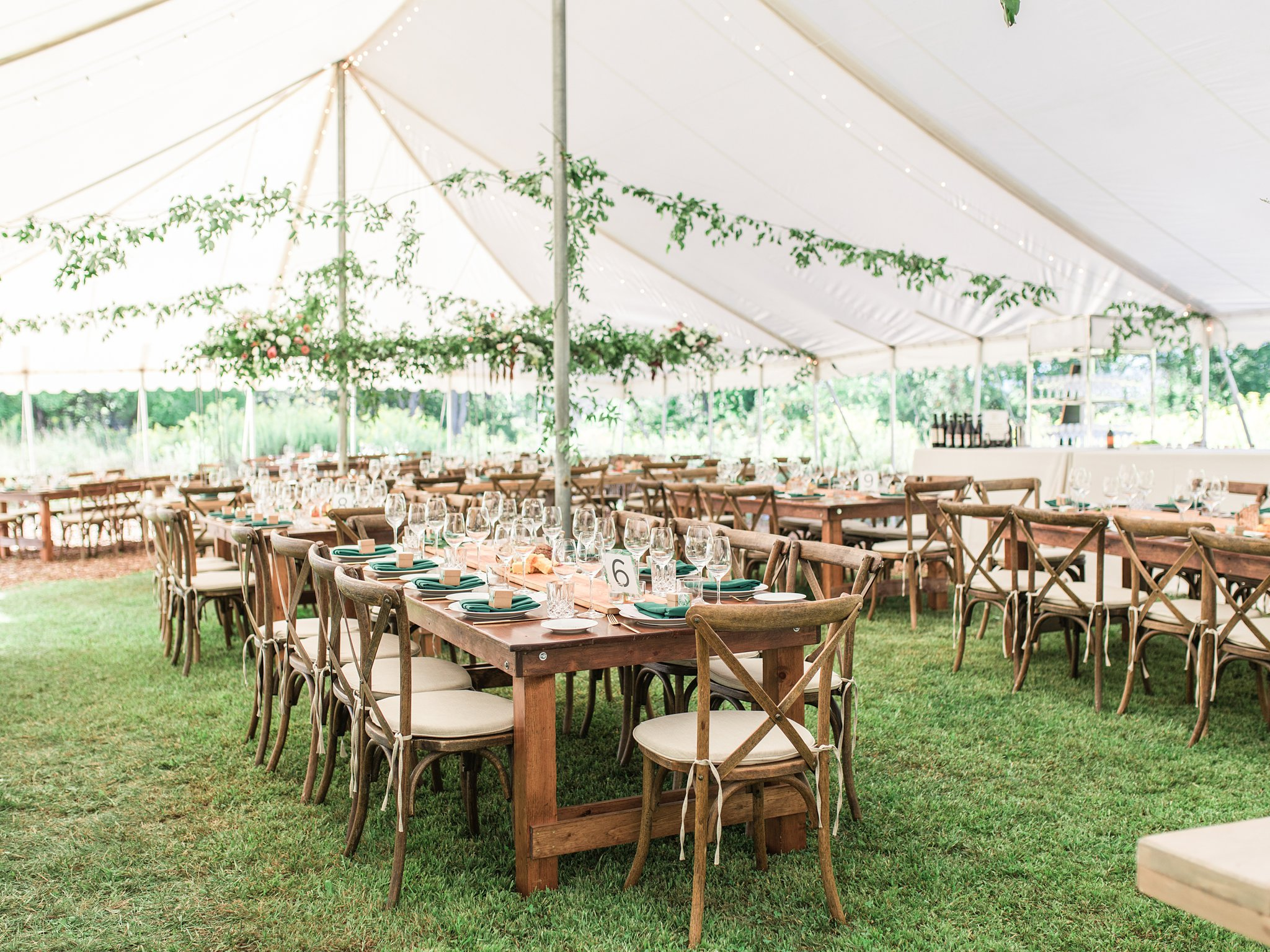 Large outdoor wedding tent, white tent, greenery, crossback chairs, forest green, Private Estate Wedding Photos, Amy Pinder Photography