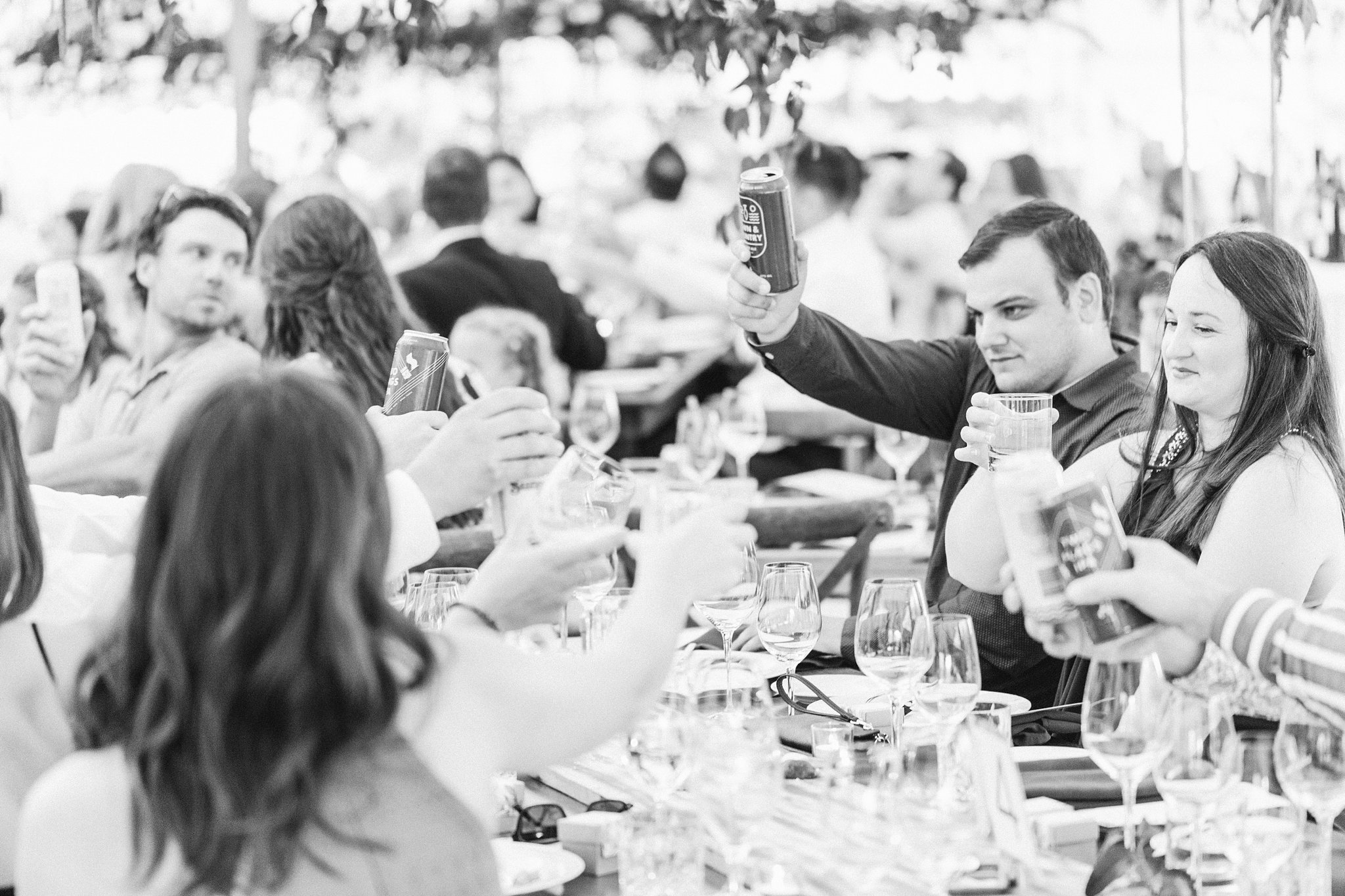 Guests cheers, reception tent, outdoor wedding, Private Estate Wedding Photos, Amy Pinder Photography