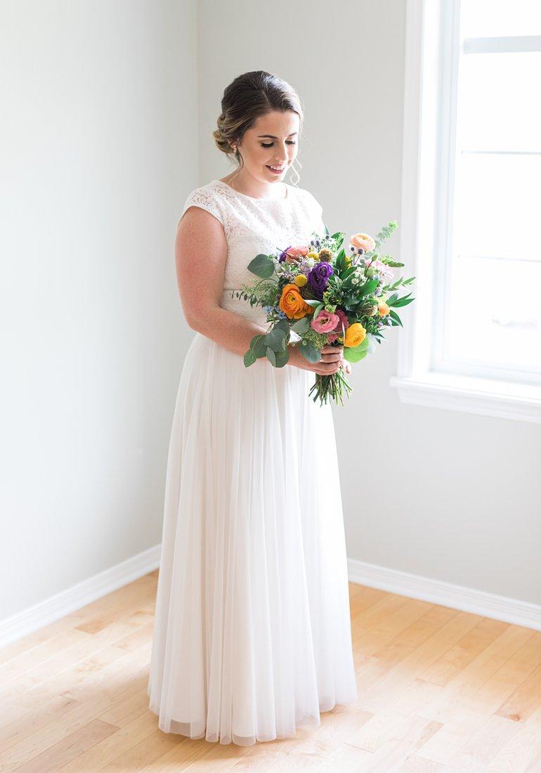Colourful bridal bouquet, bride standing in window light, Social Restaurant Wedding Photos Ottawa