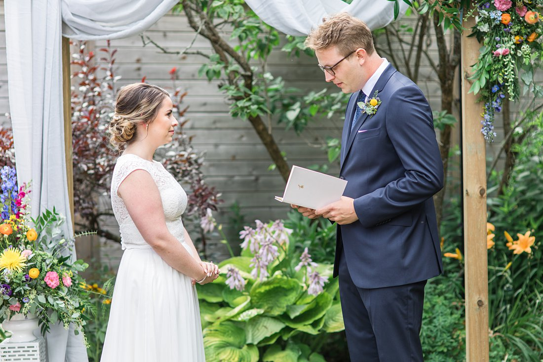 Exchanging of vows, vow book, Social Restaurant Wedding Photos Ottawa