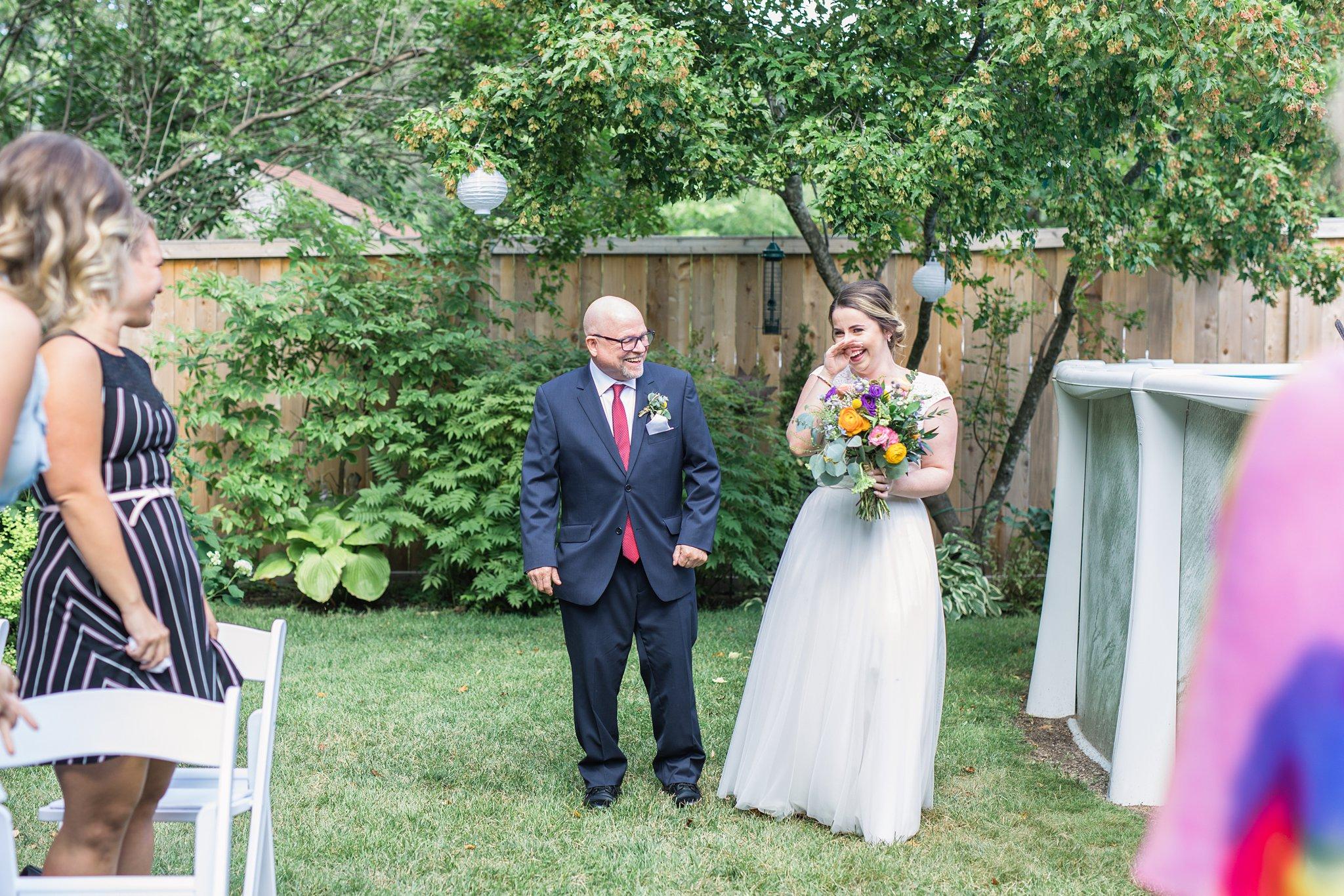 Bride laughs as she walks down the aisle, Social Restaurant Wedding Photos Ottawa