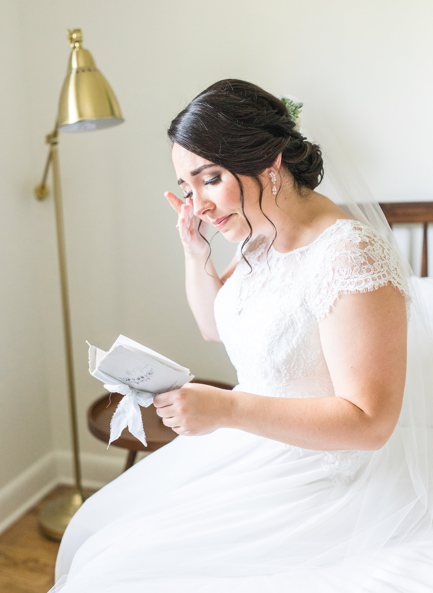 Emotional bride reading letter from groom, Britannia Yacht Club Wedding Photos, Amy Pinder Photography