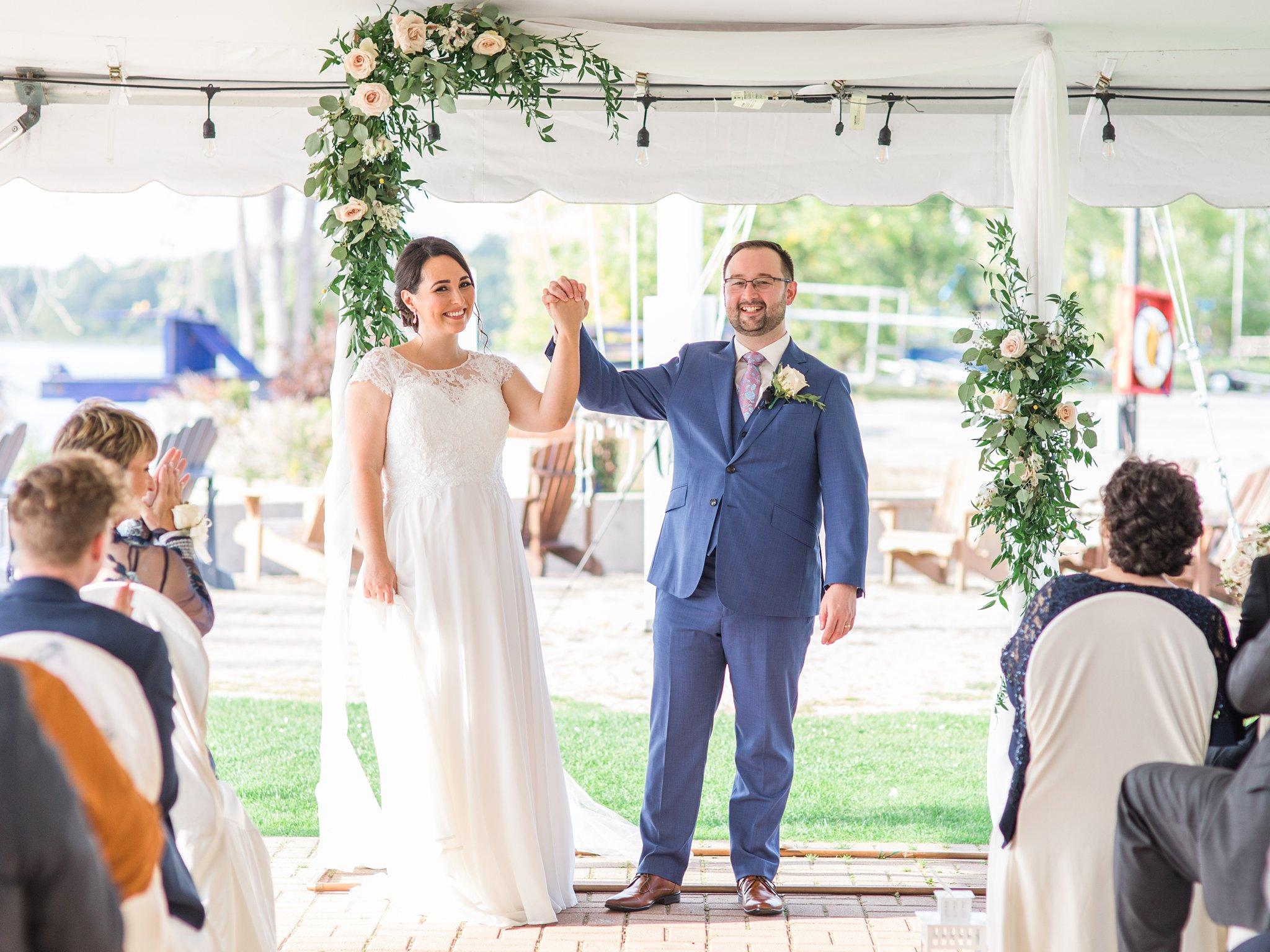 Just married newleyweds walk down the aisle, Britannia Yacht Club Wedding Photos, Amy Pinder Photography