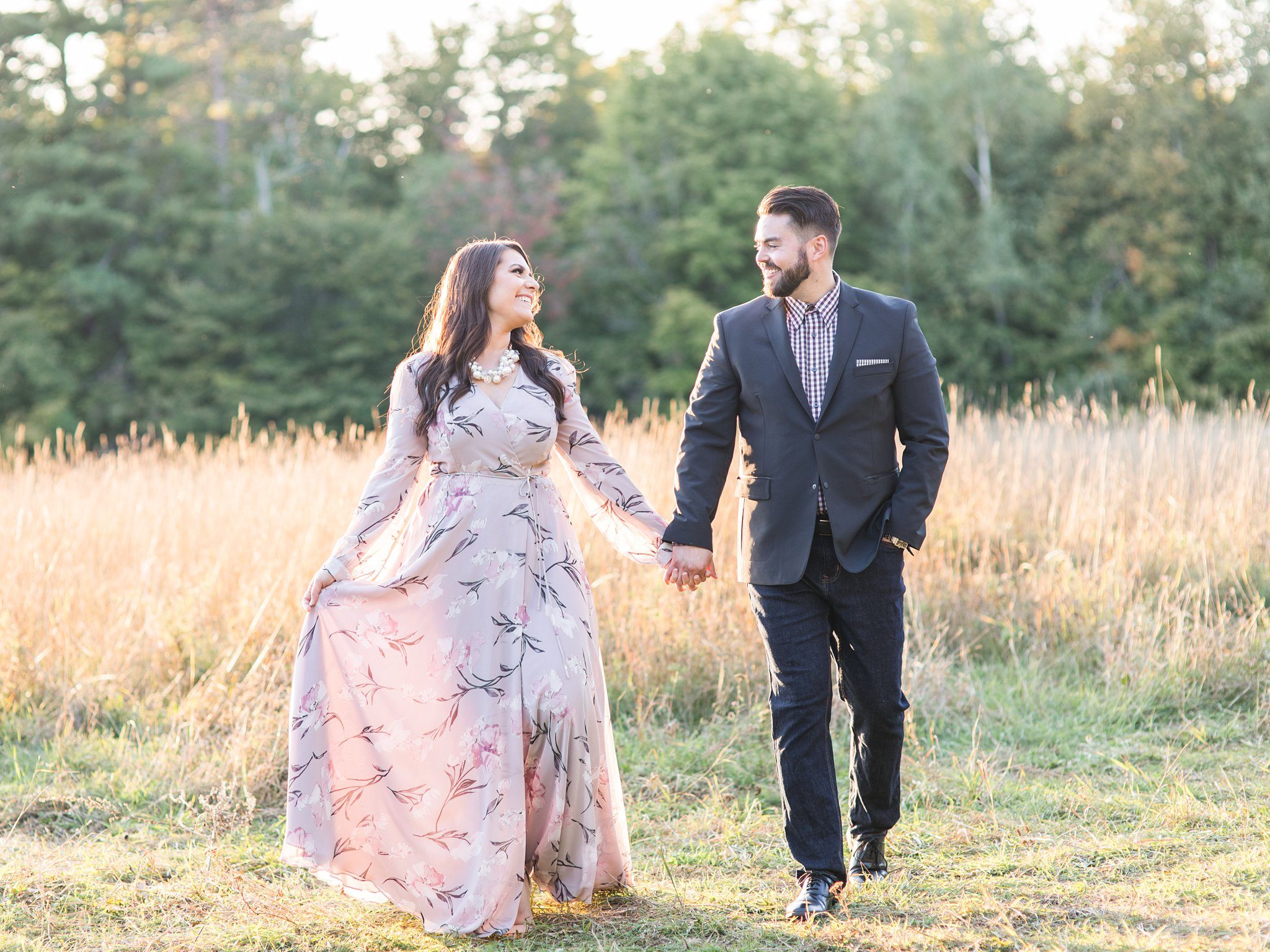 Walking hand in hand at sunset, Mackenzie King Estate Engagement Photos by Amy Pinder Photography