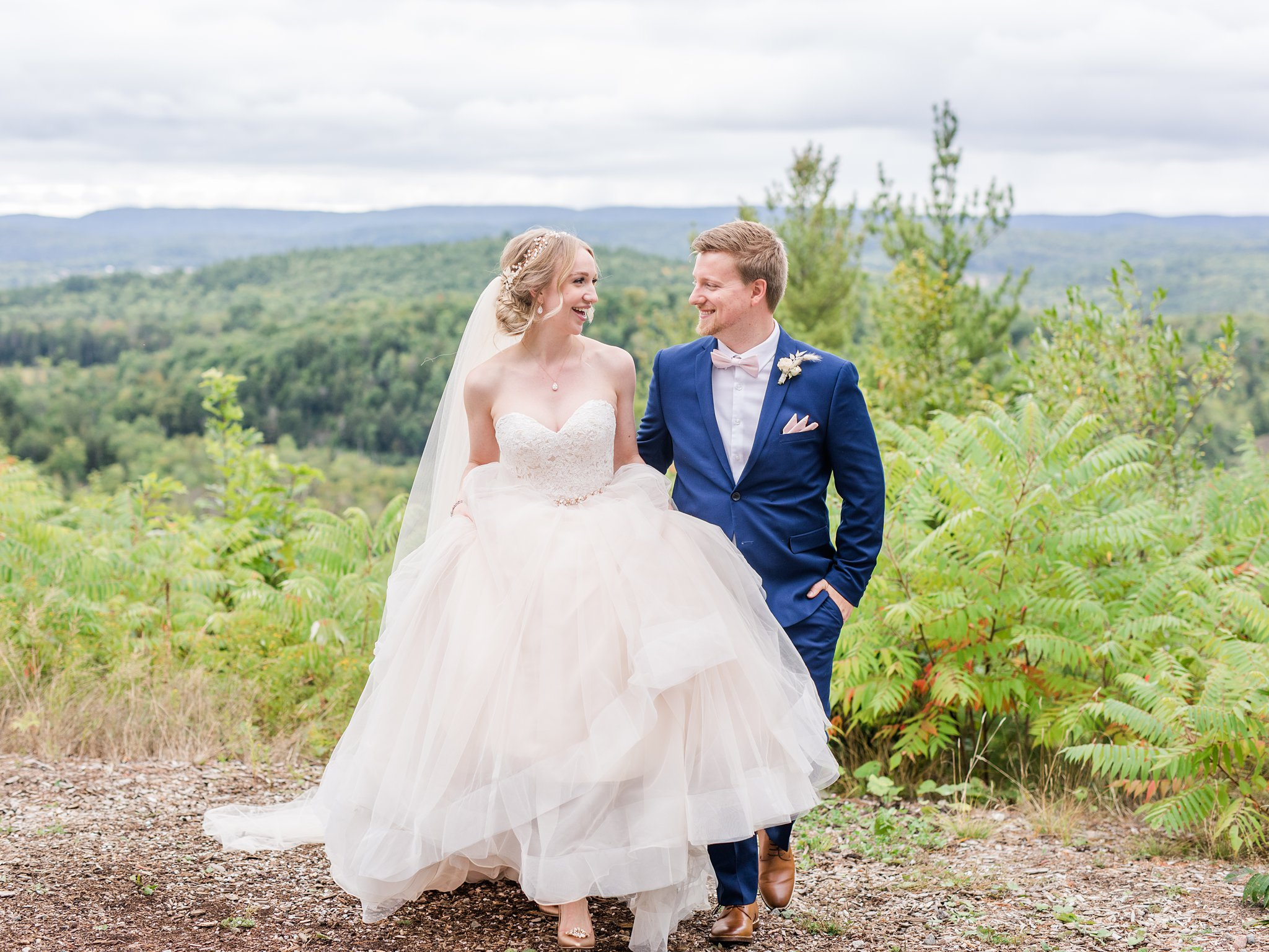 Bride and groom walking with mountain view, Wakefield wedding photos, Le Belvedere
