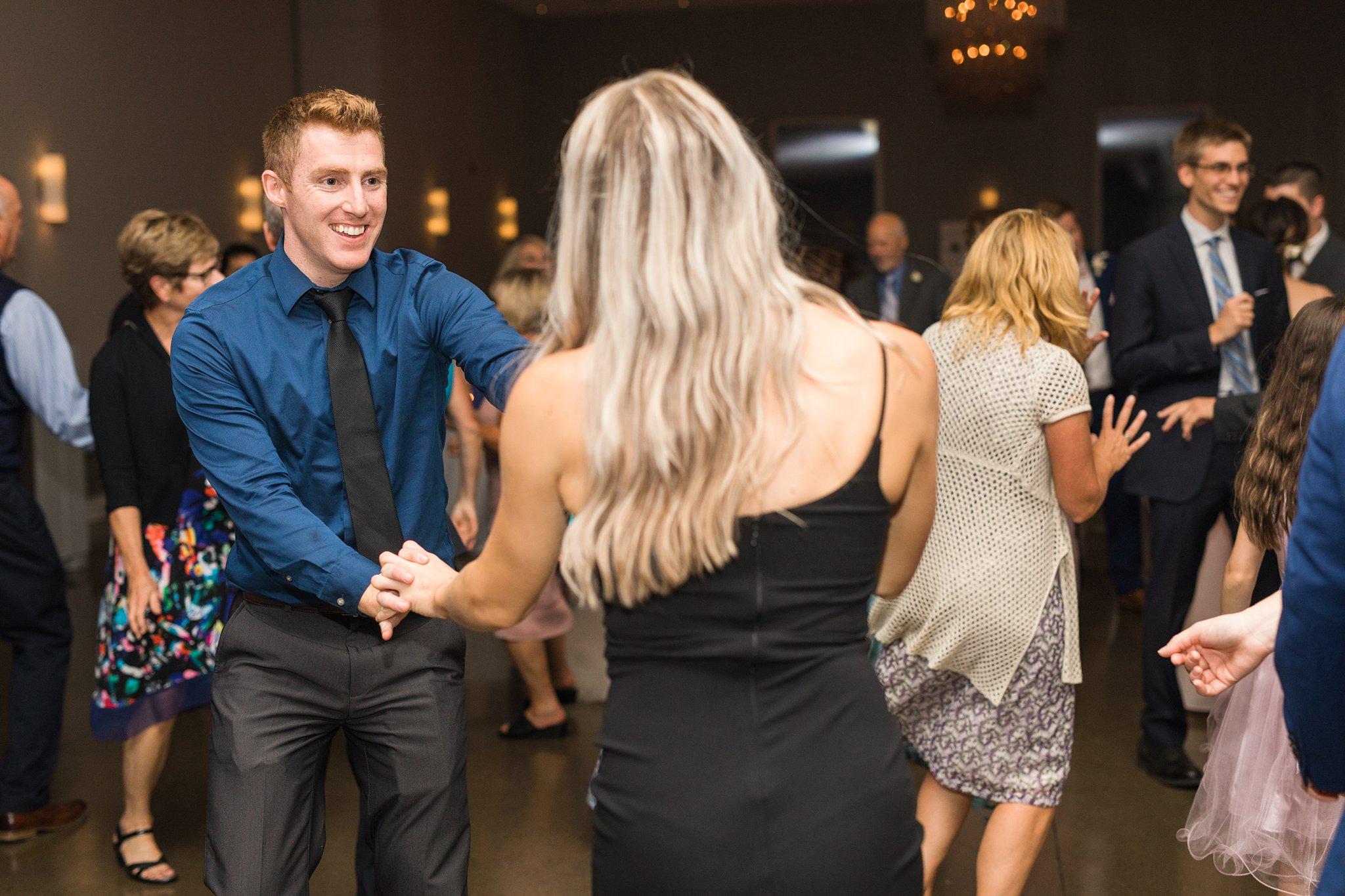 Guest twirls partner, dance floor, Wakefield wedding photos, Le Belvedere