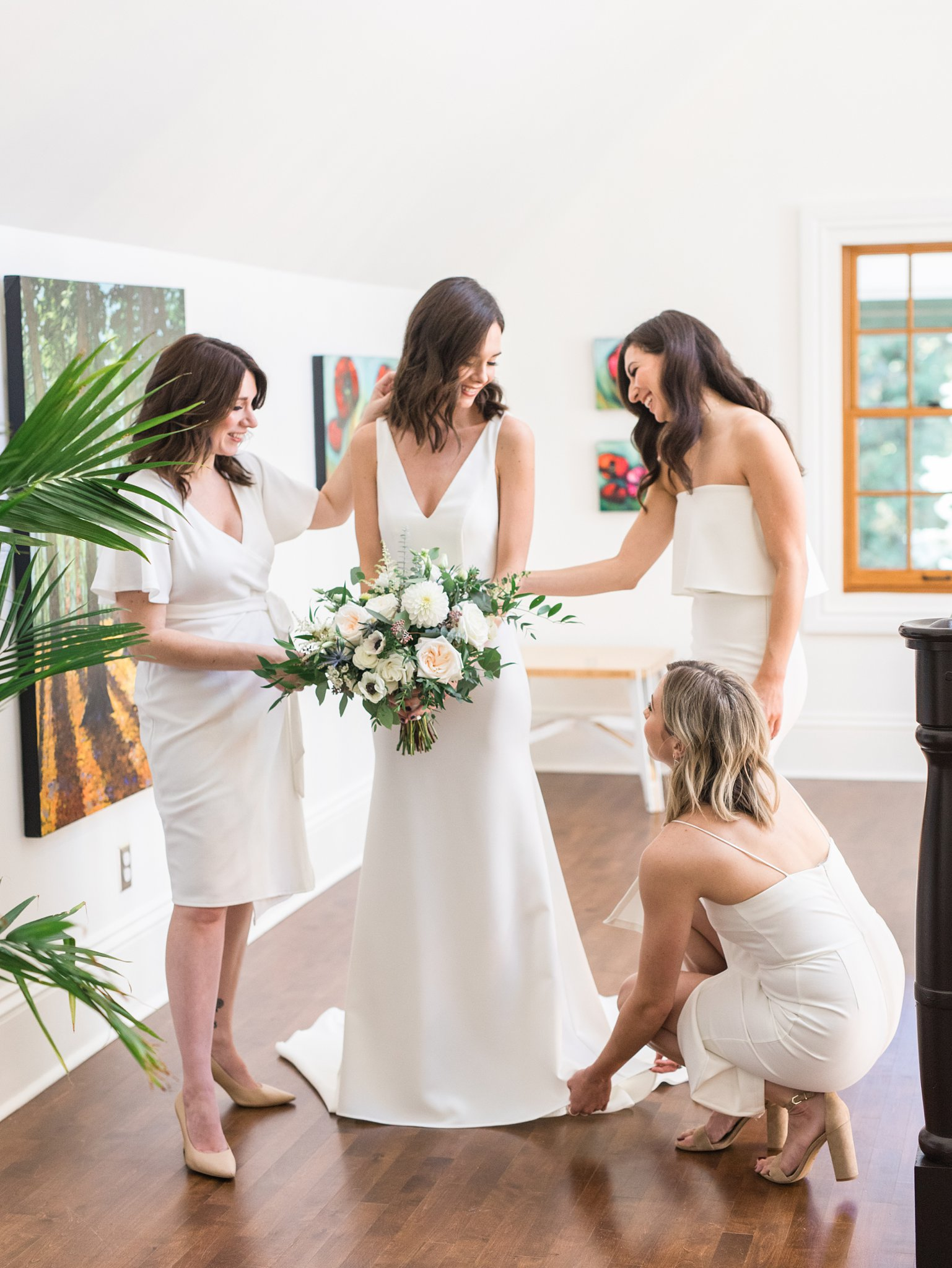 Bridesmaids help bride get ready, Opinicon Wedding Photos by Amy Pinder Photography