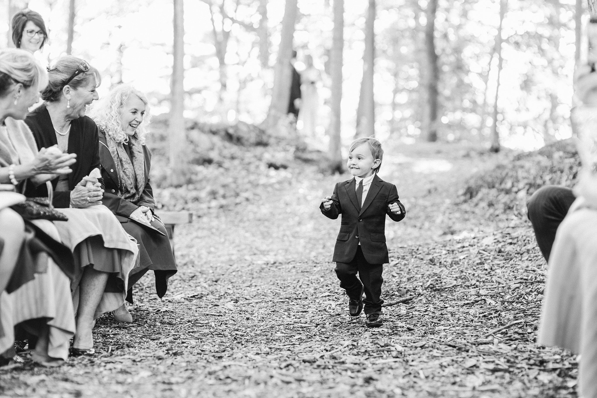 Ring bearer walks down the aisle, Opinicon Wedding Photos by Amy Pinder Photography
