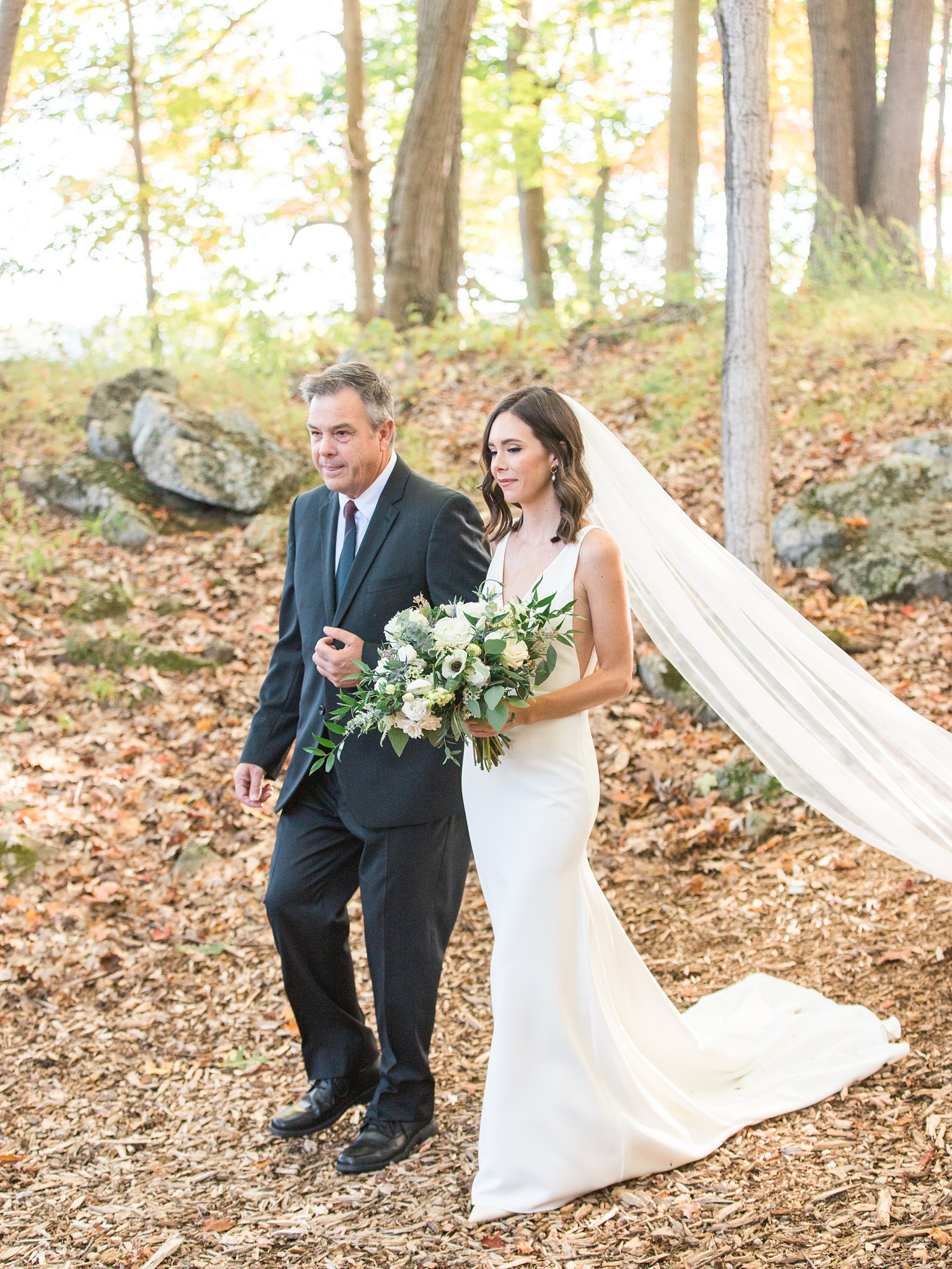 Wedding ceremony in the forest with fall colours, bride walks down the aisle, Opinicon Wedding Photos by Amy Pinder Photography