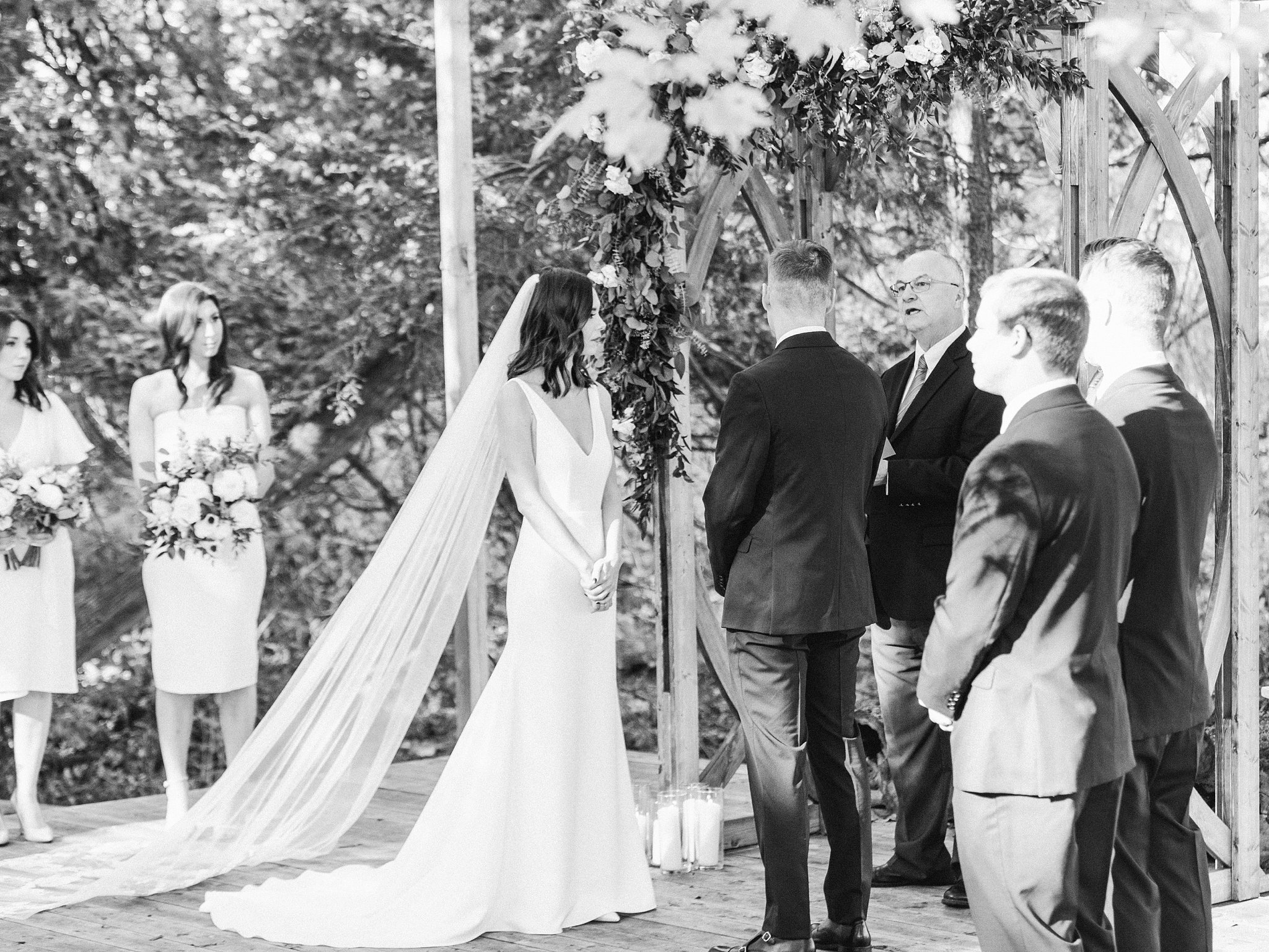 Bride and groom stand at the altar, black and white, Opinicon Wedding Photos by Amy Pinder Photography