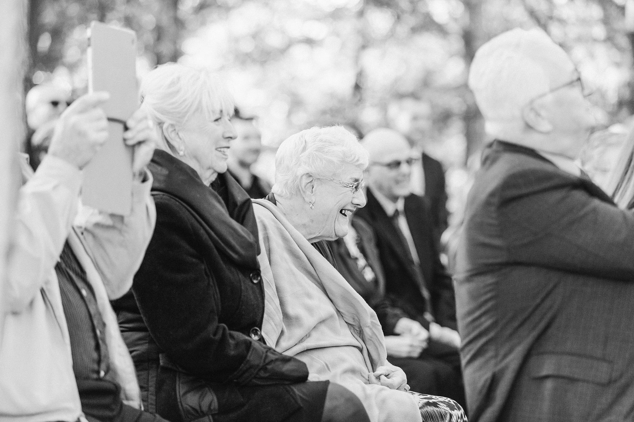 Grandma laughs at wedding ceremony, Opinicon Wedding Photos by Amy Pinder Photography