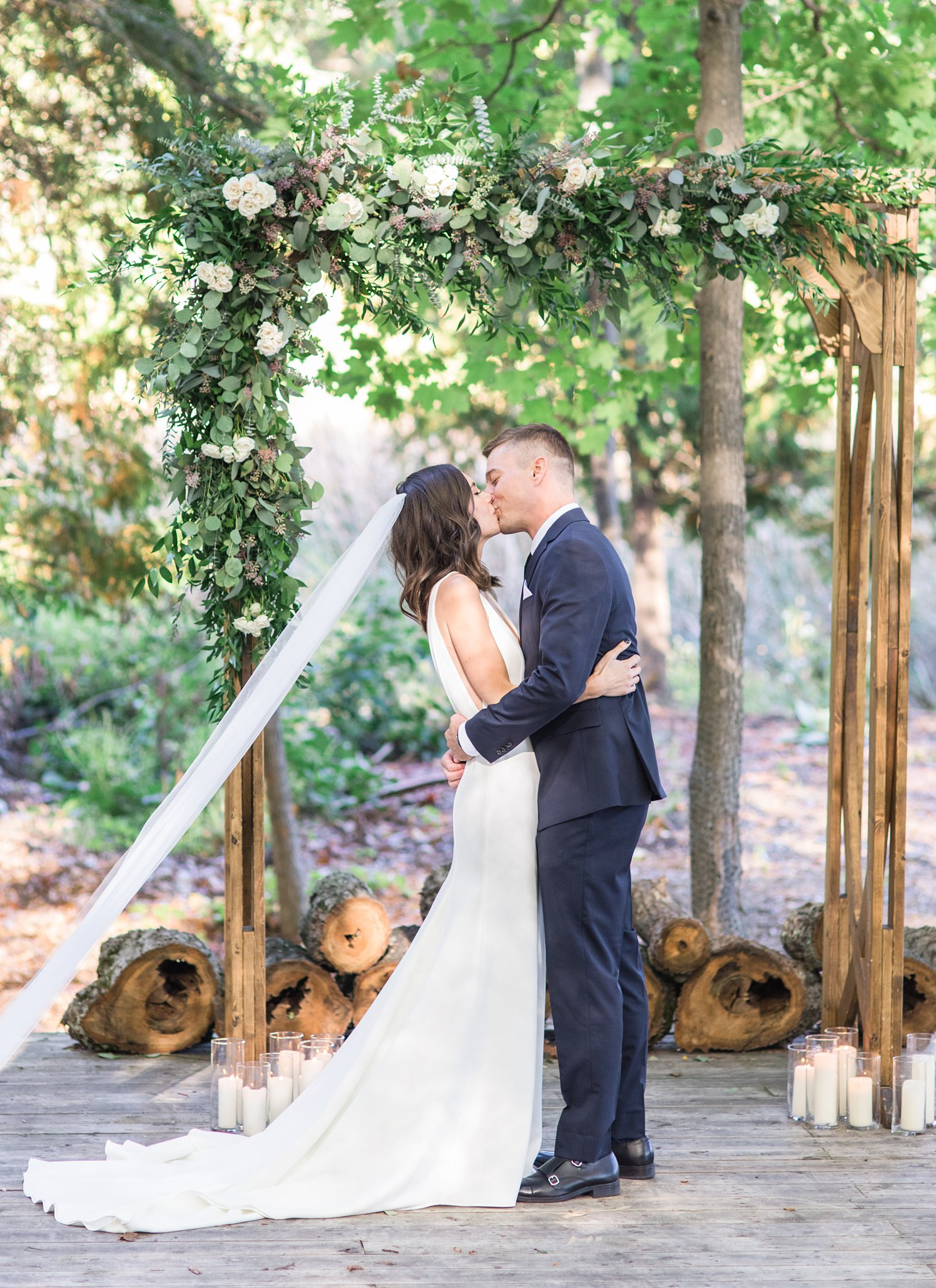 Bride and groom's first kiss, outdoor wedding, forest ceremony, Opinicon Wedding Photos by Amy Pinder Photography