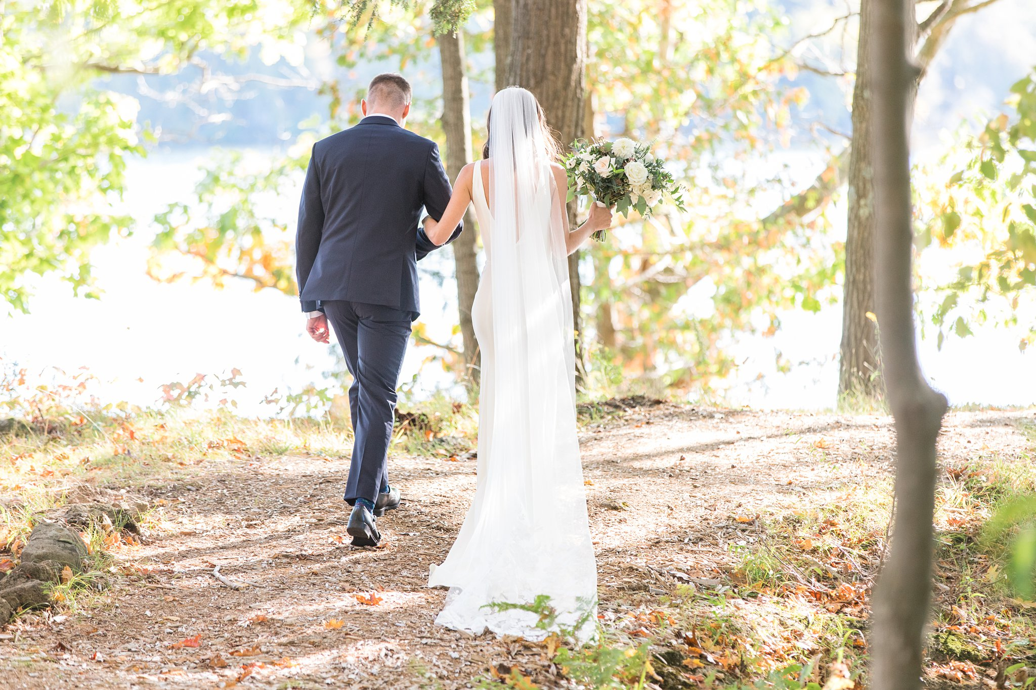 Pretty light as the bride and groom walk away from the ceremony, Opinicon Wedding Photos by Amy Pinder Photography