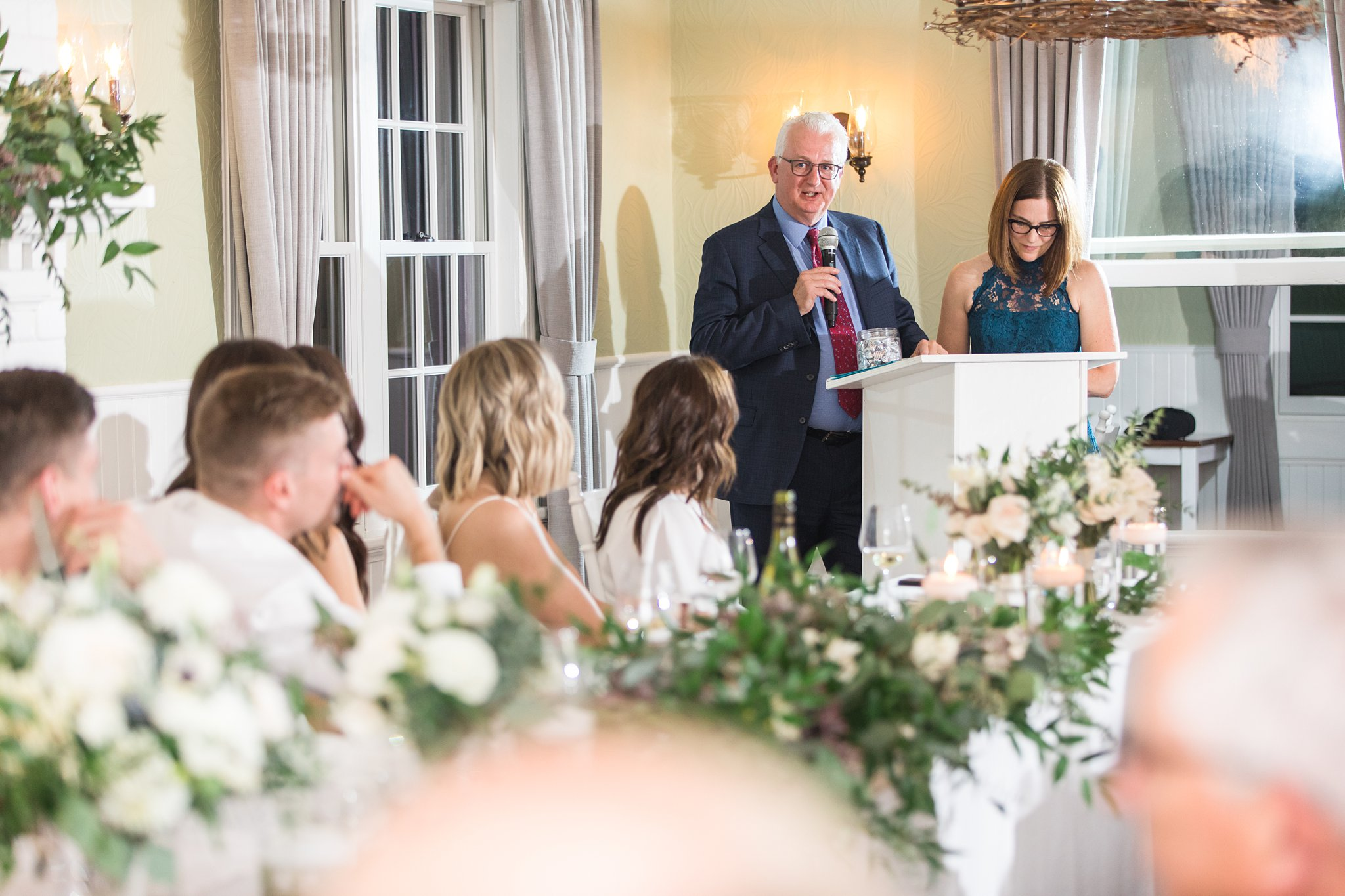 Parents give a toast at the Opinicon Wedding by Amy Pinder Photography
