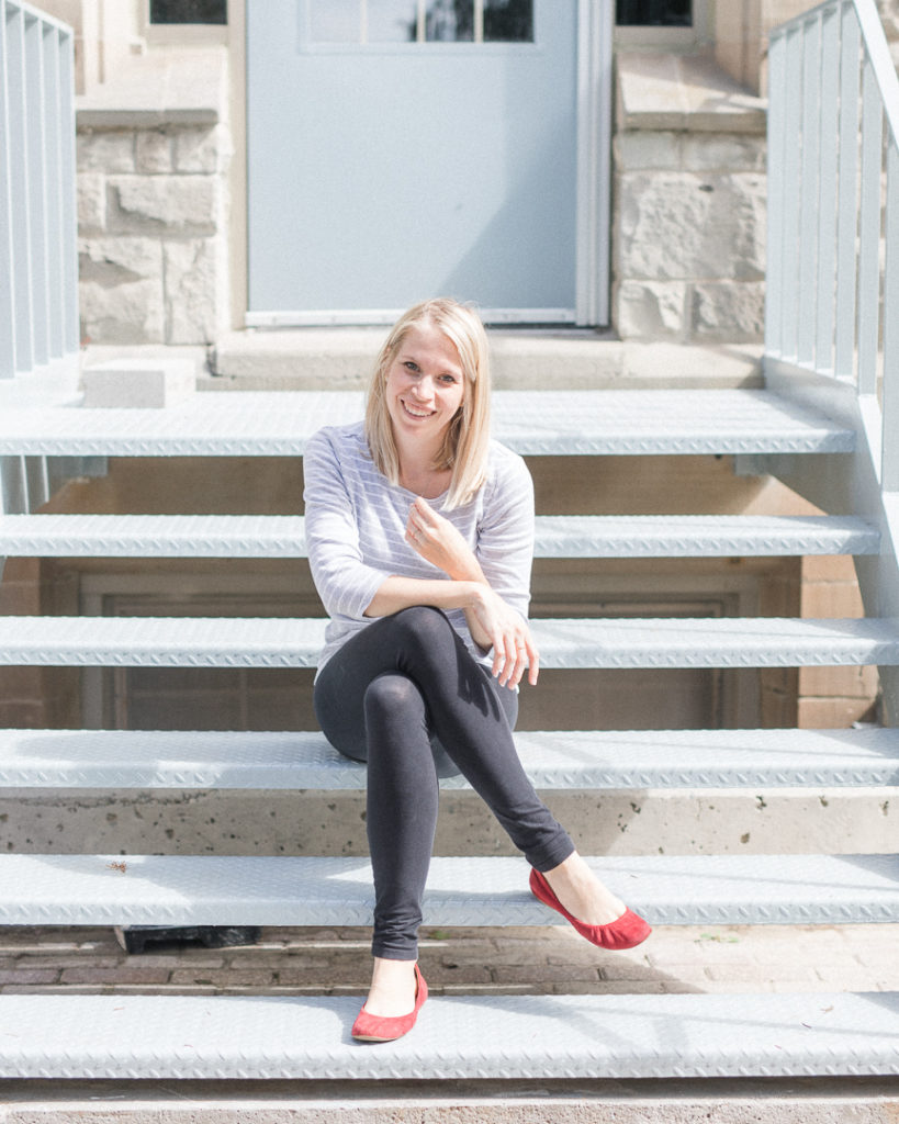 Ottawa photographer sits on stairs and smiles